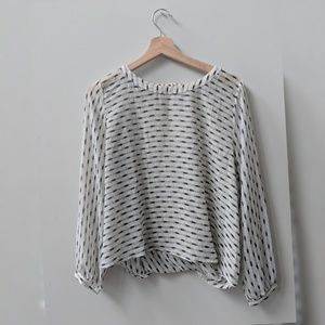 Black and White Flowing Top with Geometric Pattern
